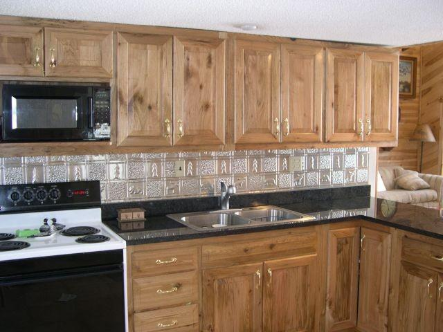 0512-gwens-cabin-clear-coated-aluminum-backsplash.jpg