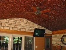 108 Faux Tin Ceiling Tiles with a floral pattern in antique copper installed in an enclosed patio room.