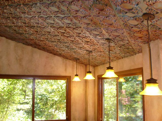 Cathedral ceiling with 3 lights and faux finished ceiling tiles.