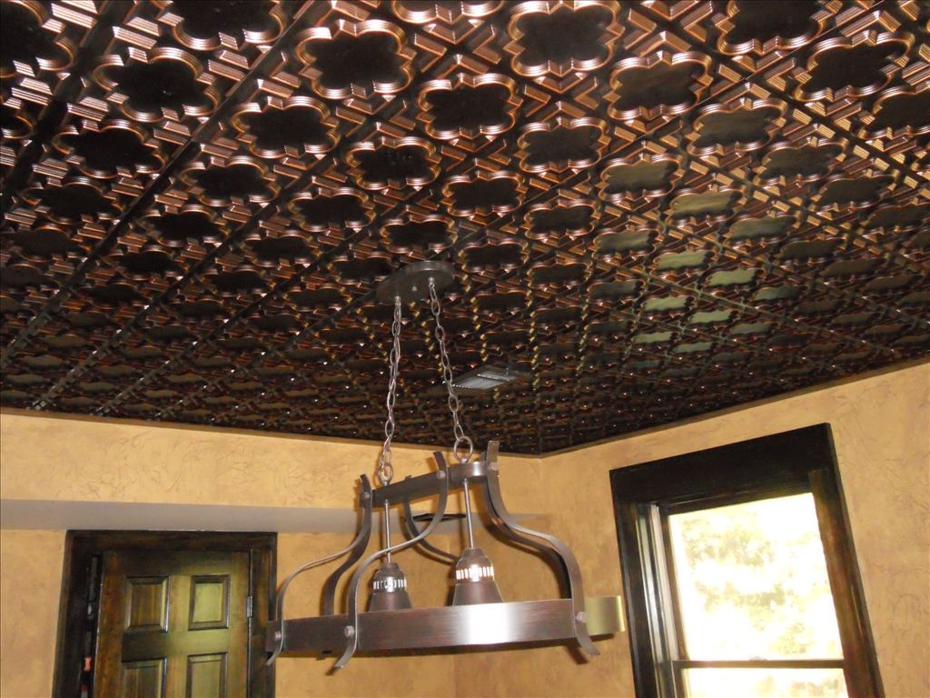 Antique ceiling copper looking ceiling tiles installed in a mancave.
