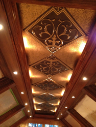 Beautiful wooden coofered ceiling is enhanced with our antique gold faux tin tiles.