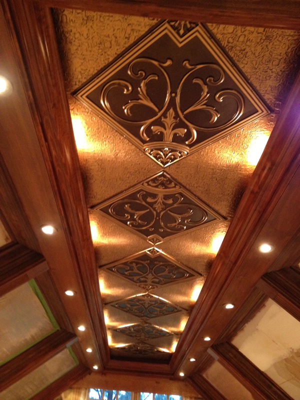 Beautiful coffered ceiling with antique gold inserts and spot lights.