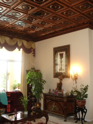 210 faux tin glue up ceiling tiles in antique copper installed in a entry room in a Boca Raton, Florida home.