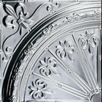 A quarter of a tin ceiling medallion with Fleur de Lis deisgn.