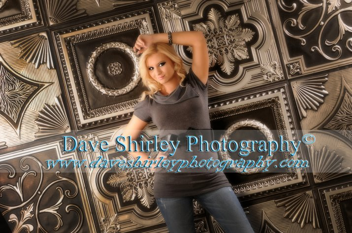 David Shirley has taken this image of a senior with our antique silver ceiling tiles.