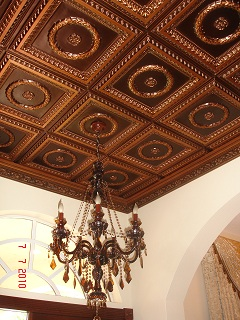 210 Antique Copper - Faux Tin Glue Up Ceiling Tiles installed on a 12 foot ceiling with a dark glass chandelier.