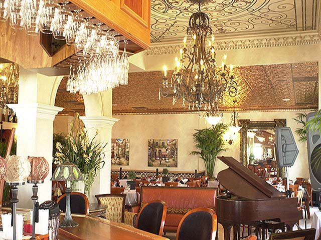 Lovely looking restaurant with piano, ceiling murals, chandelier and real copper celing tiles.