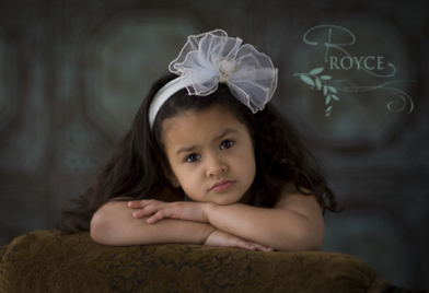 Beautiful image of a child by Royce Chenore of Royce Photography with our decorative ceiling tiles as a backdrop.