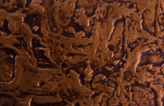 Larger hammered pattern wc40 faux tin backsplash in antique copper. Image taken of 6x4 swatch.