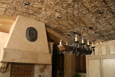 fireplace-chandelier-and-a-crusty-looking-barell-ceiling-copy.jpg
