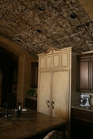 Oldworld looking kitchen with barel ceiling and faux tin ceiling tiles that were hand painted by faux artist.