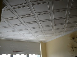 View of a ceiling with classic R24 ceiling tiles installed.