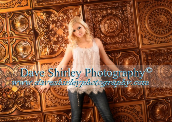 senior-portrait-against-antique-copper-photography-backdrop-tiles.jpg