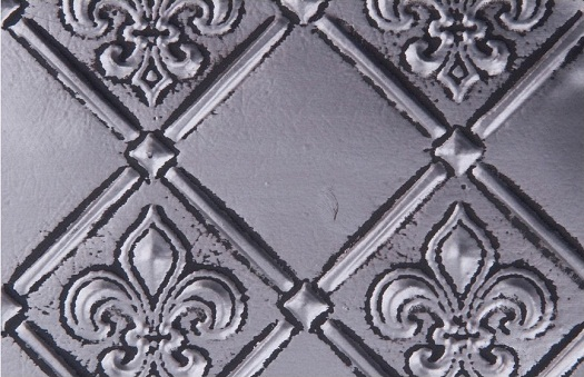 WC 80 Faux Tin Backsplash - Antique Copper has a nice fleur the lis 3d design.  The image is takeon of a 6x4 inch piece of this product.