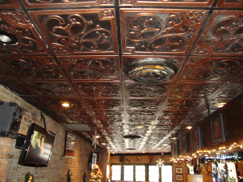 a drop ceiling with decorative ceiling tiles. There is lot of white dust on the ceiling, probably from flour. This is a restaurant and pizzeria.