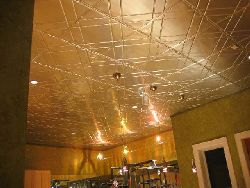 2404 Tin Ceiling Tile - Classic Floating Geometry Installed In a Home Gym