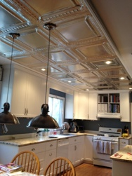 an image of a kitchen with our tin ceiling tiles in Clear Coated Aluminum finish.