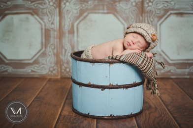 Portrait of a newborn in a bucket by Maler Photography with our tiles as a backdrop.